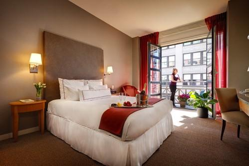 Almost all of our Guestrooms with 1 Queen Bed offer charming Juliet Balconies overlooking 26th street.