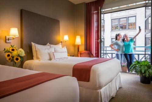 Our Balcony Guestroom with 2 Queen Beds is perfect for friends traveling together!