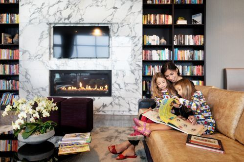 Reading by the fireplace in the Library Club Lounge