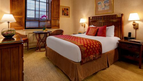 A Petite Room with 1 Queen Bed is perfect for a single traveler or couple.